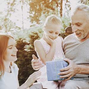 A grandpa with two granddaughters. Our Chicago therapists can help you cope with the frustrations of living with a chronic illness.