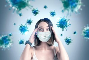 Scared Young Woman In Mask, Coronavirus Panic. Coping with health anxiety and therapy for chronic illness in Chicago, IL 60602