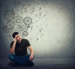 Man Sitting On The Floor Hard Thinking, Find A Solution To Solve Problem for adhd assessment and psychological testing Chicago, IL 60602 at LifePath Therapy for ADHD testing, Chicago, IL