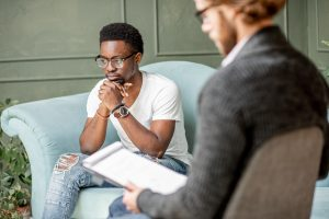 Young Man Having A Serious Conversation With Psychologist. for psychological testing chicago, il 60602 at LifePath Therapy for ADHD testing, Chicago, IL